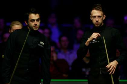 Roonie O'Sullivan and Judd Trump standing side by side during a snooker match